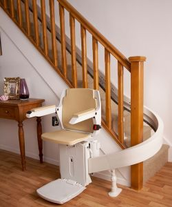 Acorn-Curved-Stairlift-at-bottom-of-staircase